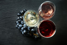 Glasses With Different Kinds Of Wine On Dark Background