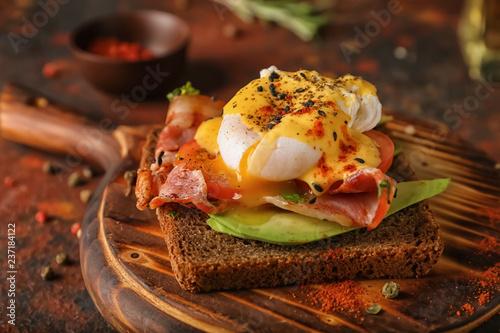 Tasty egg Benedict on wooden board Wallpaper Mural