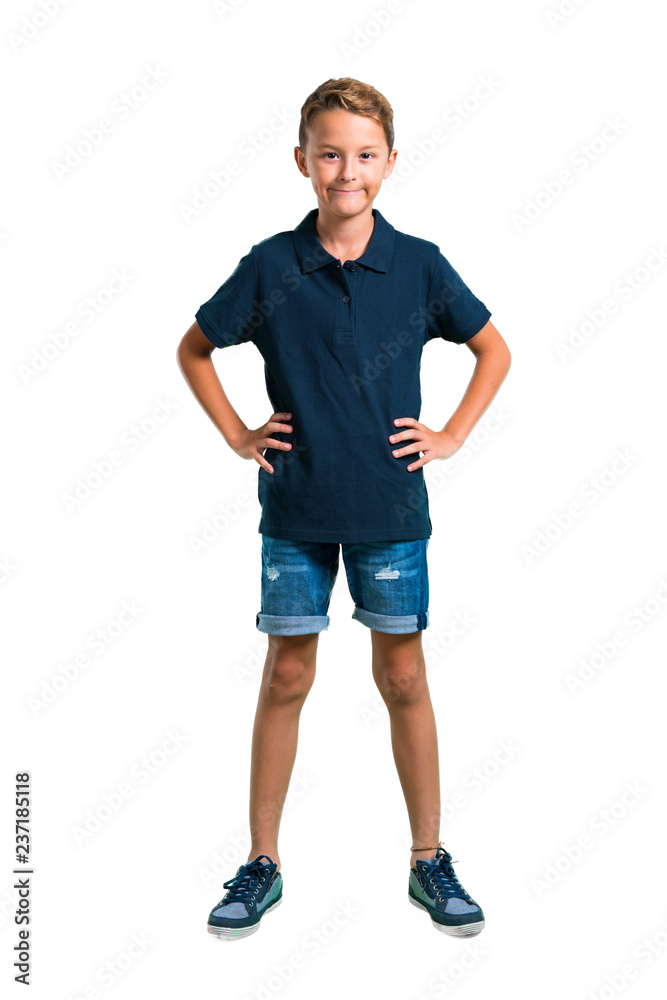 Fototapeta Full body of Little boy posing with arms at hip on white background
