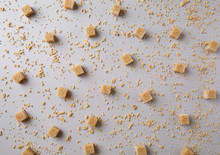 Brown Cubes With Maple Sugar Flakes On Grey Background