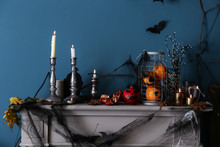 Decorations For Halloween Party On Mantelpiece