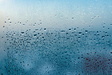 Misted Glass Background. Strong Humidity In Wintertime. Water Drops From Home Condensation On A Window