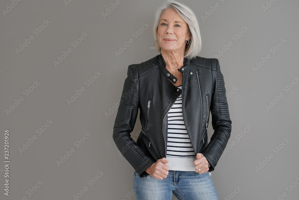 Fototapety, obrazy:  Modern senior woman in leather jacket on isolated grey background