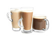 Glass cups with tasty aromatic coffee on white background