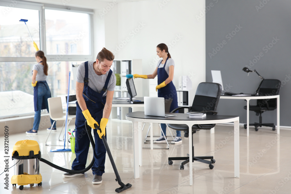 Fototapety, obrazy: Team of janitors cleaning office