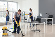 canvas print picture - Team of janitors cleaning office
