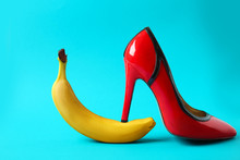 High Heel Shoe And Banana On Color Background. Erotic Concept