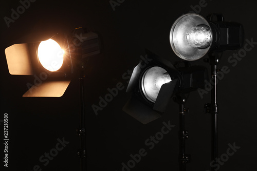 Fotografie, Tablou Professional lighting equipment on dark background