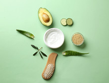 Flat Lay Composition With Avocado And Natural Cosmetics For Hair On Color Background