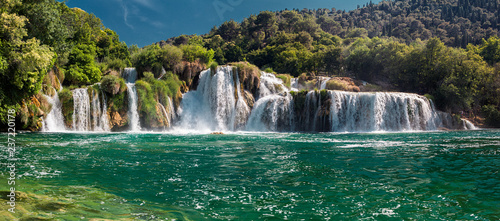 Photo Stands Waterfalls Krka National Park. Skradinski buk. Croatia