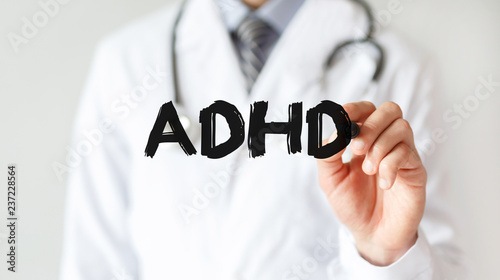Photo Doctor writing word ADHD with marker, Medical concept
