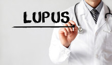 Doctor Writing Word Lupus With...