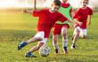 Leinwanddruck Bild - Young children players on the football match