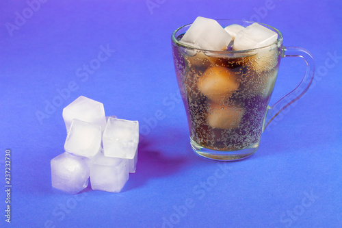 Fototapeta black carbonated drink in a transparent cup with ice obraz na płótnie