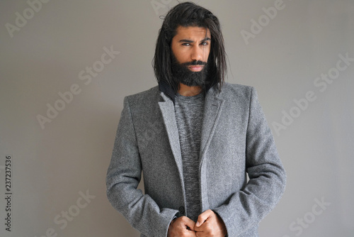 Fotografie, Obraz  Hipster guy with grey coat, isolated