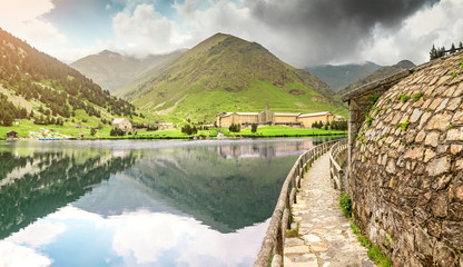 Fototapeta na wymiar Panoramic view of the Nuria Valley with lake in the Catalan Pyrenees, Spain