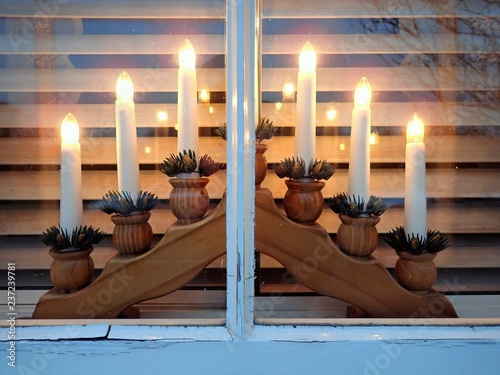 Advent candlestick with seven electric lights on window sill Wallpaper Mural