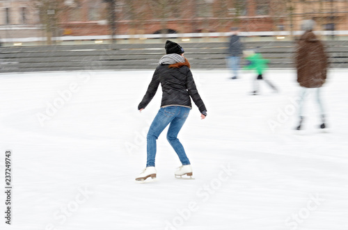 Skating on the ice rink.