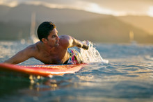 Male Surfer Lies On His Board,...