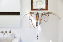Jewelry On Stag Horn In Bathroom Of Home