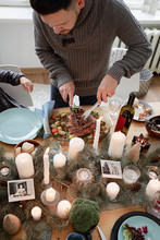 Man Carving Meat On Christmas Dinner