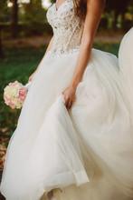Bride Holds Her Wedding Dress