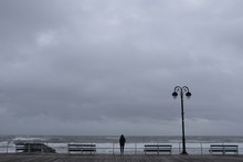 Person Looking At Stormy Ocean.