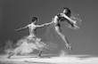 canvas print picture - ballet pair of dancers duet jumping with flour.