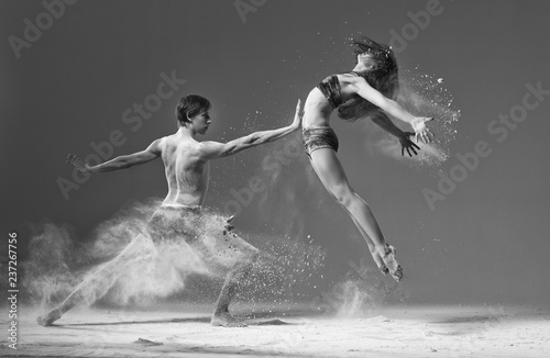 ballet pair of dancers duet jumping with flour.