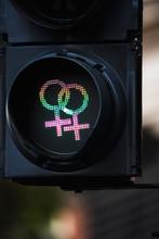 Close Up Of Traffic Lights With Female Gender Symbols