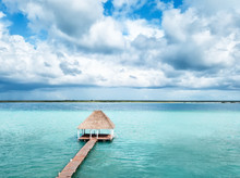 Wooden Palapa Pier And Turquoise Blue Lagoon