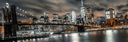 brooklyn bridge night long exposure with a view of lower manhattan