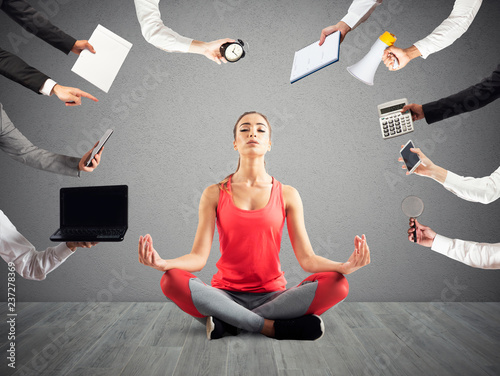 Woman tries to keep calm with yoga due to stress and overwork at wok