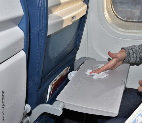 Fotografie, Obraz  Wiping dirty airplane tray