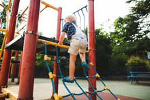 Young Boy Playing At A Playground