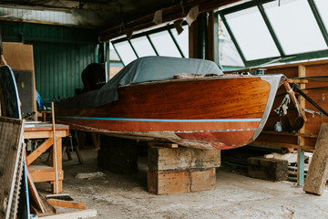 Old wooden boat in a garage