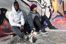 Casual Skateboarders At Graffi...