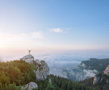 Woman On High Cliff Embracing The Infinite Sea Of Clouds