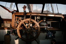 Wooden Steering Wheel, Interior Of The Captain's Cabin Of A Vintage Ship