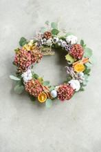 Christmas Wreath With Dry Flowers On Gray Concrete Background
