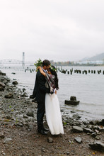 Couple Embraced On River Shore
