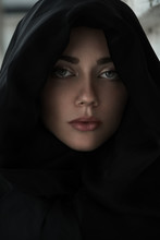 Portrait Of A Young Woman In A Hood