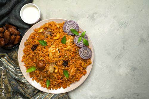 Homemade chicken Biryani. Arabic traditional food bowls kabsa with meat. Top view.