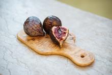 Ripe Figs On Olive Tree Board