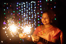 Woman Having Fun With Sparkler During Diwali