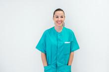 Happy Young Nurse In Green Uni...