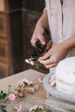 Person Cutting Flowers For Cake