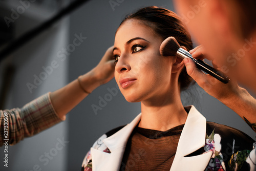 Photo  Model getting a touch up