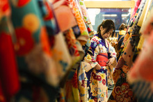 Young Asian Woman Dress Up With Japanese Kimono In Kimono Rental Shop In Japan