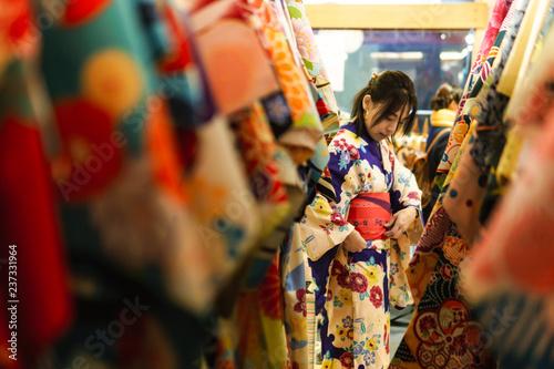 Fototapeta Young asian woman dress up with japanese kimono in kimono rental shop in japan